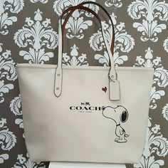 Limited edition Coach Snoopy City Zip Tote i Limited edition Coach Snoopy City Zip Tote in chalk white. This beautiful limited edition Coach Snoopy bag is sold out in stores. New with tags attached. Coach Bags Totes