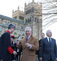 He grinned broadly as he stood against theDean of Durham Cathedral...