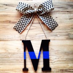 A personal favorite from my Etsy shop https://www.etsy.com/listing/256415403/police-door-hanger-thin-blue-line-door