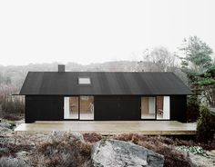 cabin, summerhouse, black wood, plywood interior, rocks, nature, foggy, scandinavian retreat.