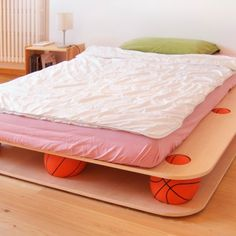 """""""dino"""" is a completely demontable bed formed by two multilayer panels and nine basket balls fit between the two panels in apropiate seats."""