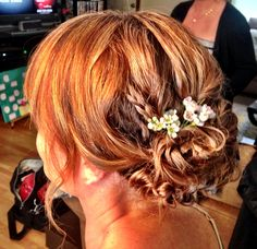 Bridesmaid updo with some loose curls and braids