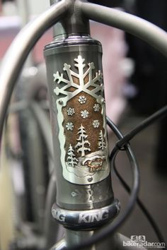 Yet another gorgeous themed head tube badge from Black Sheep Bikes, this time adorning the front of a snow bike.