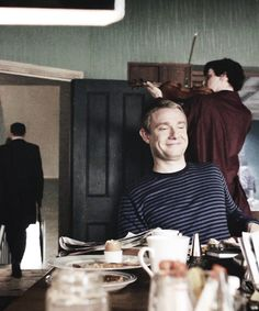 John's face as Sherlock follows Mycroft out to annoy him: 'That's my boy.'