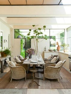 Lusting after these wicker arm chairs and that rustic farm table!