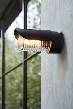 The Beacon Lighting Docker long eyelid IP65 weatherproof rated exterior in black with ribbed glass