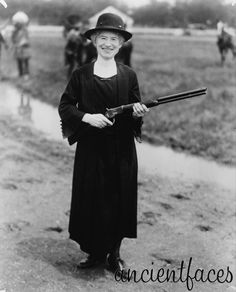 The famous Annie Oakley, first popular female sharpshooter and star of Buffalo Bill's Wild West Show taken in 1922.  http://www.ancientfaces.com/research/photo/419431/annie-oakley-with-buffalo-bill-gun-family-photo
