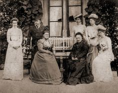 Prince Alfred Duke of Saxe Coburg Gotha and his family at Rosenau. from left to right: Princess Beatrice, Prince Alfred, Princess Maria, Duchess Alexandrine of Saxe Coburg Gotha (nee Princess of Baden), Princess Victoria Melita, Princess Alexandra and Princess Marie (the future Queen of Romania).