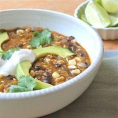 Black Bean, Tomatillo, and Corn Soup topped with avocado, lime, cilantro and chipotle sour cream