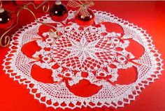 """Watch Maggie review this beautiful Poinsettia Angel Doily Crochet Pattern! ) Design by: Soledad Davis Size: Finished doily - 22"""" diameter; White Poinsettia center - 9"""" diameter; One Angel = 6"""" Length"""