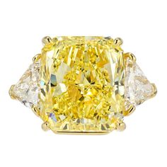 Bulgari Fancy Intense Yellow 21.07 carat Diamond Ring | From a unique collection of vintage engagement rings at http://www.1stdibs.com/jewelry/rings/engagement-rings/