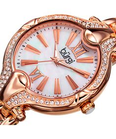 Bürgi Swarovski® Crystal & Rose Goldtone Bracelet Watch | zulily  . $62.99 $395.00 Standard Description:  Enriched with crystals from Swarovski® and flaunting a glittering goldtone bracelet, this watch wraps your wrist in a layer of shining decadence.      Case: 35 mm diameter     Bracelet: 16 mm W x 7'' L     Butterfly closure     Case and bracelet: alloy     Bezel: Swarovski® crystal     Japanese quartz movement  . 2-year limited warranty Imported