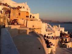 Crowd watching the sunset at Oia, Santorini Oia Santorini, Crowd, Opera House, Sunset, Building, Travel, Sunsets, Viajes, Buildings