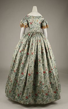 Evening dress     Date: 1850s     Culture: French     Medium: silk     Dimensions: Length (from shoulder): 55 3/8 in. (140.7 cm)  ...