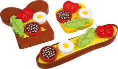 Das ganz andere Fast Food - verschiedene Brote mit täuschend echten Beilagen! Ei, Tomate, Salat und Wurst sind mit Magneten versehen und können so nach Belieben auf den Broten platziert werden. Im Handumdrehen zaubern die Kleinen kreative Snacks. Aber Achtung - auch wenn das Wasser im Munde zusammen läuft, diese kleinen Snacks können leider nicht verzehrt werden!  ca. 11 x 11 x 2,5 cm