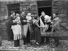 Fathers in Blaenrhondda, south Wales, prepare to take their babies out for a walk, as is the custom in the area. The men carry their children in large shawls. Get premium, high resolution news photos at Getty Images Women In History, Family History, British History, Old Photos, Vintage Photos, Welsh Blanket, Saint David's Day, Cymru, Swansea