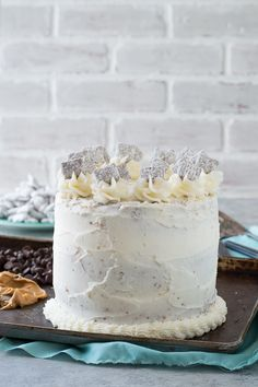 Puppy Chow Cake - chocolate and peanut butter cake loaded with puppy chow in between each layer!