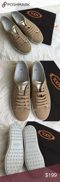 New Tod's sneaker shoes New no box,dust bag included,authentic! Bought it for myself but it's too small for me,(I'm 9.5) fits true to size!never been outside Suede Sneakers Beige And Gold Impeccably crafted in Italy, Tod's sneakers take luxe footwear to a more casual level. Made from soft suede, this style features a gripped rubber sole for increased comfort and traction. Let them give leather leggings and an oversized cardigan a dressing down.  Upper: goat leather, lamb leather  Lace-up…