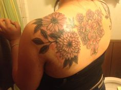 Evan's Birth Flower = Calendula (the lower one on the left shoulder blade)
