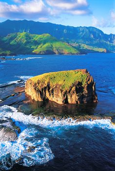 Aerial view of Ua Huka with a mighty rock in the foreground. Marquesas Islands, French Polynesia. Credit: P. Bacchet