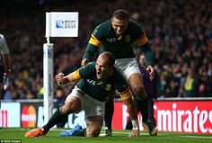 Scrum-half Fourie du Preez celebrates scoring the decisive late try for South Africa as Wales were knocked out of the World Cup
