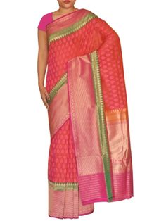 Details: Extraordinary beautiful bridal red saree with allover floral motifs densely woven and heavy wide zari border on both sides. Specification: Length: 5.5 meters Width: 1.1 meter Blouse Piece: Yes, 80-90 cms