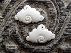 Have your head in the clouds wearing earrings made from these - Little Cloud Carved Bone Beads Earring Pair $8.00 USD from Indounik, based in Bali, Indonesia, and selling on Etsy #jewelry