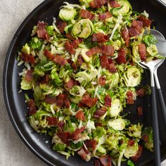 Warm Brussels Sprout Slaw with Bacon | Apples bring sweetness and bacon brings saltiness to this irresistible side.