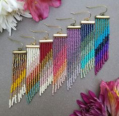 These long, lightweight earrings are easy to wear and full of color and movement. They are hand-woven with needle and thread using bold chartreuse, turquoise luster, teal, blue iris, purple, and fuchsia Czech and Japanese seed beads, cascading from an antique brass bar. These earrings