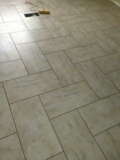 12x24 tile in herringbone pattern with sahara beige grout | home