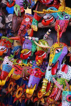 Colorful wooden masks, Chichicastenango Market, Guatemala