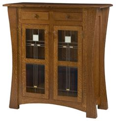 "Arts & Crafts Pie Safe w/Glass in Oak - 1"" Solid top w/beveled edge - Flush dovetailed drawers - Full extension drawer slides - Flush soldered glass doors - 2 Adjustable shelves - Arched legs - Square wood knobs - Optional lighting, additional cost 18"" D x 44 1/2"" W x 47 1/2"" H $1,324.00"