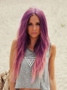 Love the colour at the top. Purple to baby pink ombré on long hair. Lighter ends make it look grungey.