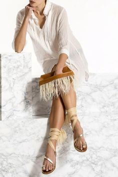 Bring a glamorous edge to your evening look with the Domna design clutch. Handmade of fine quality leather and silky feathers, this unique and elegant piece comes in 3 colors, camel/brown (waxed tan), black and nude (nubuck). Greek Chic Handmades Women's bags are designed and handcrafted in Athens, Greece. Shop your favorite leather bag to accompany your handmade sandals. Most importantly we use the same premium leather we built the sandals with and the impeccable local craftsmanship. Wedding Sandals For Bride, Bridal Sandals, Leather Clutch Bags, Ivory Sandals, Bohemian Style, Boho Chic, Black Leather, Athens Greece, Tattoo