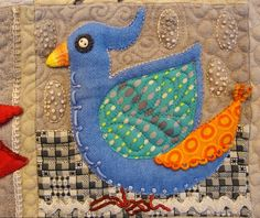 detail from Bird Dance by Sue Spargo, wool applique wall quilt