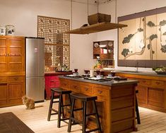 This has a similar look to the kitchen's layout and cabinets. Right now everything is painted red. I think the original color would have been more like this. I really love the wall piece with the cranes too.