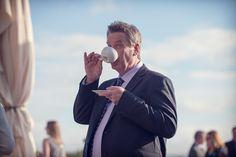 Wedding guest drinking tea. Photography by one thousand words wedding photographers www.onethousandwords.co.uk