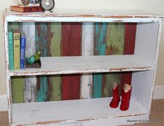 Upcycled bookcase:  slats for the back are cheap.