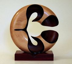 Don Keefer -- This sculpture is turned from a single block of maple