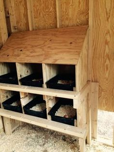 Inside our chicken coop. The buckets make it an easy clean up, and the slanted roof prevents hens from nesting on top of the boxes.