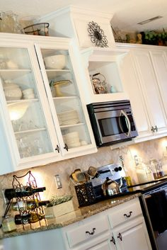 White cabinets, travertine backsplash color of countertop: Scissors & Spatulas {and everything in between}