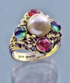 Bernard Instone. Arts and Crafts ring. Gold, tourmaline and pearl. Marks: Signed 'BI'. British, c. 1930. Sold by Tadema Gallery. by hattie