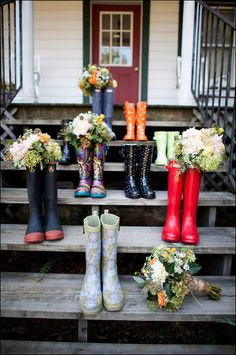 Rainy wedding day! Cute idea for bridesmaids to have rain boots and take a picture with their bouquets in the boots!
