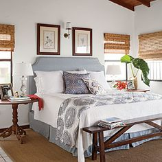 Love the cute bench at the end of the bed. Charming St. Kitts Cottage | 6. Refresh With Fabric | CoastalLiving.com