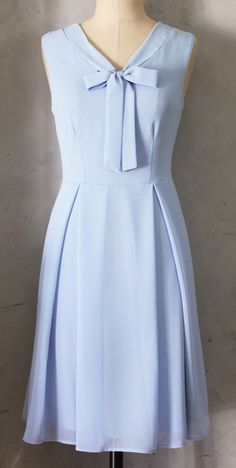 Such a cute classy vintage-inspired dress. I love the periwinkle color and the bowtie at the neck is darling. I'd love to add some bowtie dresses or tops to my wardrobe.