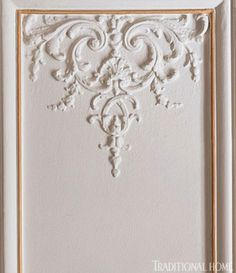"""Ornate plaster molding adorns the living room wall panels, which are painted """"China White"""" from Benjamin Moore. Plaster Mouldings, Decorative Mouldings, Moldings, Ceiling Design, Wall Design, House Design, Classic Interior, Home Interior Design, Romantic Paris"""