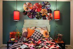 Wall art -- colorful magazine pages, accordion fold and glue. Together into pinwheels. cheap and fun apartment or dorm decorating