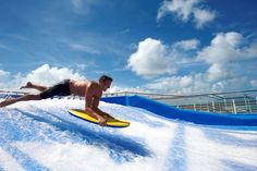 Surf's up! Try our FlowRider, a surf simulator, onboard #OasisOfTheSeas #cruising #travel