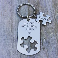 This is a great way to show a loved one that they complete you. This stainless steel dog tag keychain contains a cut out puzzle piece. Attached to the key ring is a stainless steel puzzle piece which can be custom stamped with a special date or name. Please let me know in notes to seller when you place your order what you would like stamped on the puzzle piece.