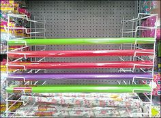 Mirror Image Gift Wrap Arms on Pegboard